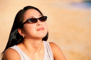 Woman in sunglasses on beach